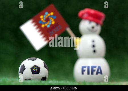 Symbol Of Soccer World Cup Qatar 2022 On A Snow Man - Stock Photo