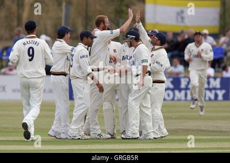 Andy Carter of Essex (4th L) celebrates the wicket of Ian Westwood with his team mates - Essex CCC vs Warwickshire - Stock Photo