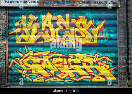 graffiti on roller shutter door in Hackney wick, London. - Stock Photo