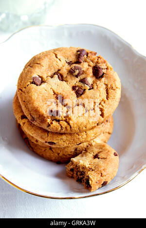 Chocolate chip cookies in white bowl close up - Stock Photo