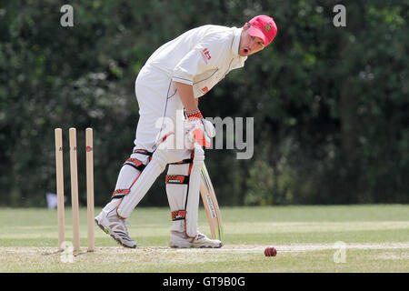 Joe Craddock looks back to his his stumps after being bowled out - South Woodford CC vs Hainault & Clayhall CC  - Stock Photo