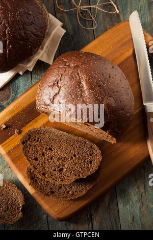 Homemade Organic Pumpernickel Rye Bread Cut into Slices - Stock Photo