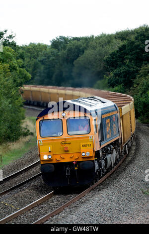 GBRf empty stone train pulled by a class 66 diesel locomotive at Hatton, Warwickshire, UK - Stock Photo
