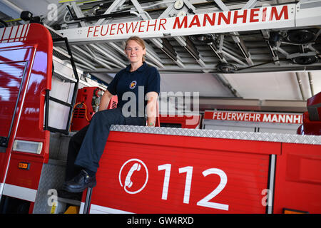 Mannheim, Germany. 24th Aug, 2016. Firewoman Lisa-Katharina Roeck sits on a fire engine at the southern fire station - Stock Photo