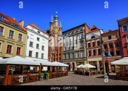 Red brick gothic facades on the central square in Torun, Poland, the birth place of Nicolaus Copernicus - Stock Photo