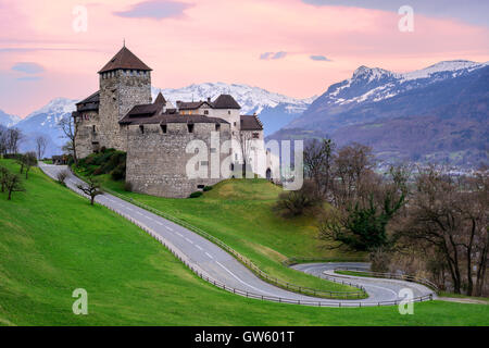 Vaduz Castle, the official residence of the Prince of Liechtenstein, with snow covered Alps mountains in background - Stock Photo