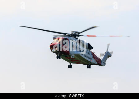 Sikorsky S92A G-MCGH UK Coastguard in flight at North Coates Airfield - Stock Photo