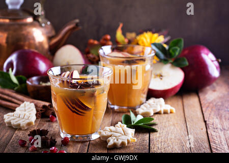 Mulled apple cider with little cookies - Stock Photo