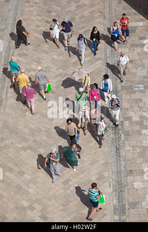 DUBROVNIK, CROATIA - MAY 26, 2014: Aerial view from old city walls of tourists walk on Stradun, 300 meters long - Stock Photo