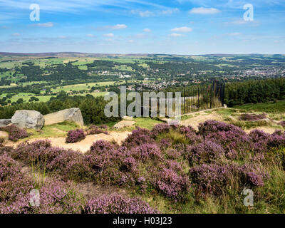 View over Ilkley from the Swastika Stone at Woodhouse Crag Ilkley Moor West Yorkshire England - Stock Photo