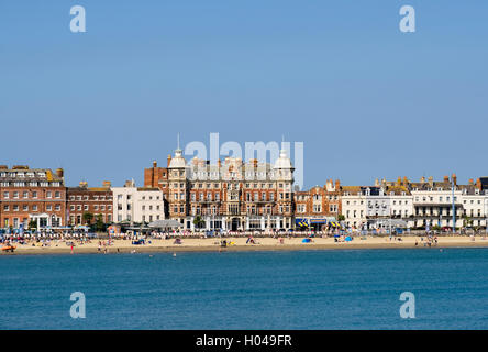 Royal Hotel and Arcade on seafront from across sea in late summer sunshine in south coast resort of Weymouth Dorset - Stock Photo