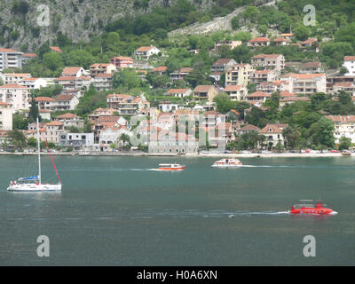 Boats and Yachts Sailing on the Blue Adriatic Sea, Kotor Bay, Montenegro - Stock Photo