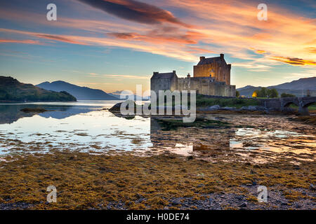 Beautiful sunset over the castle at Eilean Donan in the Scottish Highlands - Stock Photo