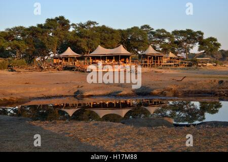 Somalisa Camp in the evening light, Hwange National Park, Matabeleland North Province, Zimbabwe - Stock Photo
