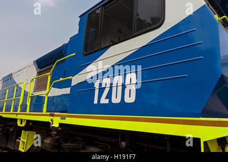Operations for transporting and managing iron ore. New locomotive added to the fleet used to pull full iron ore - Stock Photo