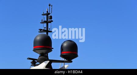 Communication antennas on a luxury yacht - Stock Photo