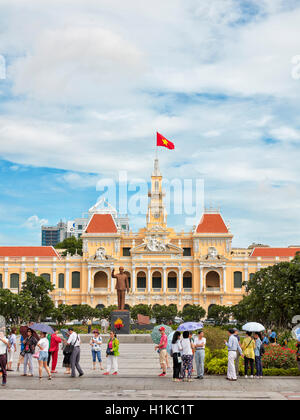 Ho Chi Minh Statue in front of People's Committee Building. Ho Chi Minh City, Vietnam. - Stock Photo