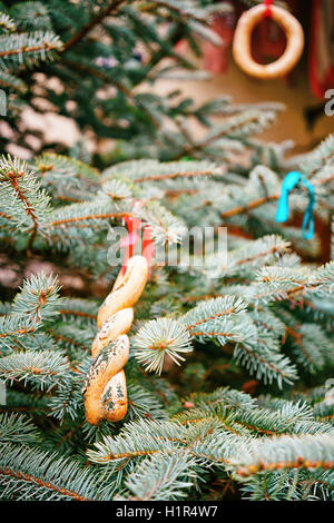 Christmas tree decorated with cookies at the streets of Riga in Latvia. The Christmas tree is one of the main symbols - Stock Photo