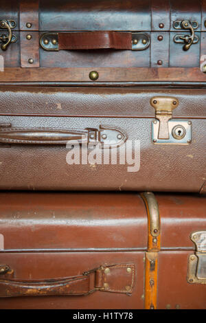 Close-up of three old suitcases - Stock Photo