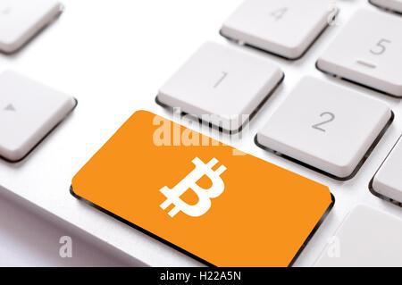 Bitcoin on keyboard - Stock Photo