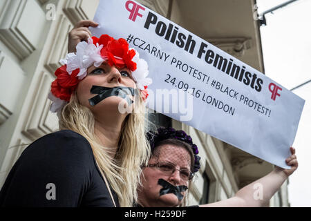 London, UK. 24th September, 2016. Protest outside the Polish Embassy in London against Poland's right-wing lawmakers - Stock Photo