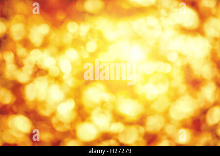 Shining out-of-focus highlights in gold and yellow, a bright bokeh background ideal for autumn or Christmas - Stock Photo