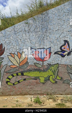 Latino street art, Puerto Ordaz Venezuela. Green Iguana and butterfly - Stock Photo