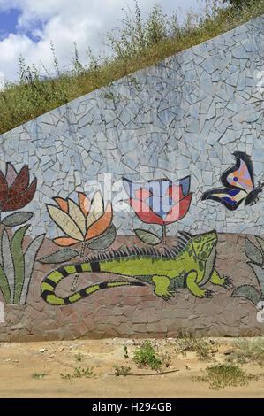 Latino street art, Puerto Ordaz Venezuela. Green Iguana and butterfly. - Stock Photo
