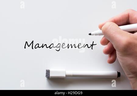 Human hand writing management on whiteboard - Stock Photo