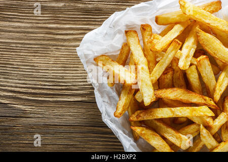 French fries on wooden table - Stock Photo