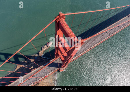 Aerial view of Golden Gate Bridge suspension tower, cable and road above San Francisco Bay in California. - Stock Photo