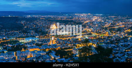 Tbilisi, Georgia. The Scenic Panoramic Top Field Of Vision. Cityscape In Evening Illumination With All Famous Landmarks - Stock Photo