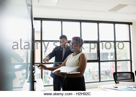 Business people with laptop working in conference room - Stock Photo