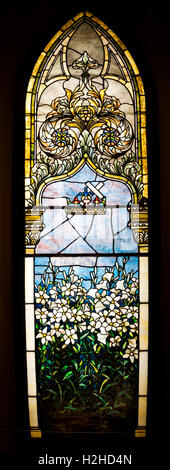Corey Memorial Window or Lilies by the Tiffany Glass & Decorating Company. - Stock Photo