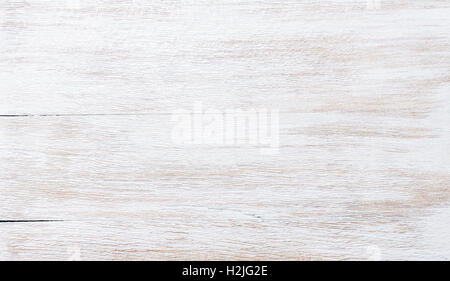 Old threadbare white painted wooden texture, wallpaper or background - Stock Photo
