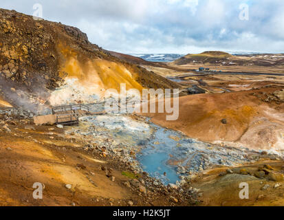 Boardwalk over steaming ground, mineral deposits, Seltún geothermal area, Krýsuvík volcanic system, Reykjanesfólkvangur - Stock Photo