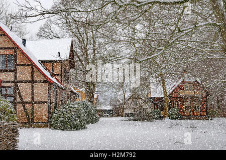 Houses situated at ramlosa brunnspark on the outskirts of Helsingborg in Sweden during a heavy snowfall. - Stock Photo