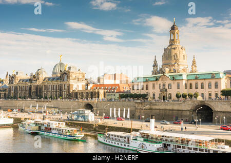 DRESDEN, GERMANY - AUGUST 22: Tourists at the promenade of the river Elbe in Dresden, Germany on August 22, 2016. - Stock Photo