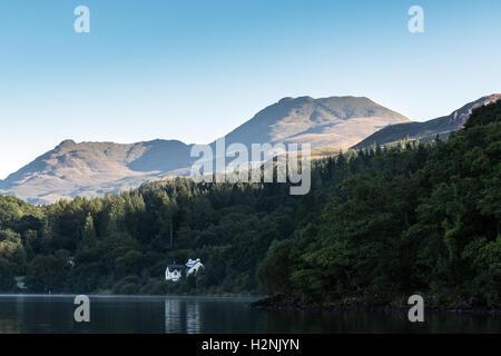 Ben Lomond and Loch Lomond in early morning sunshine - Stock Photo