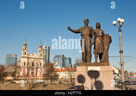 Vilnius, Lithuania - March 16, 2015: Soviet realism sculptural group 'Agriculture' on the Green bridge. - Stock Photo