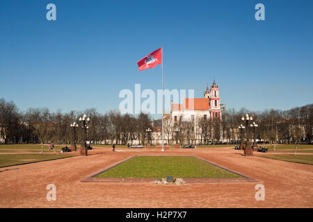 Vilnius, Lithuania - March 16, 2015: Lukiskes Square with Coat of arms of Lithuania flag. - Stock Photo