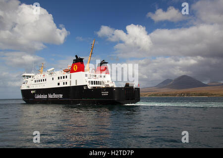 Isle of Islay, Scotland. The CalMac ferry MV Finlaggan transiting the Sound of Islay, with the Isle of Jura in the - Stock Photo
