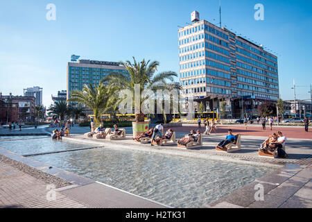 KATOWICE, POLAND - AUGUST 25, 2016: The recently constructed area in the city center for people to sit by the water. - Stock Photo