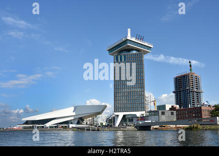 Waterfront of Amsterdam Noord district with modern building of EYE Film Institute and Amsterdam Tower The Netherlands, - Stock Photo