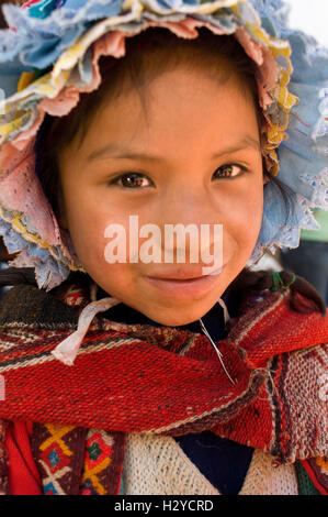 Young girl dressed in traditional costume in Pisac Sunday market day. Pisac. Sacred Valley. Pisac, or Pisaq in Quechua, - Stock Photo