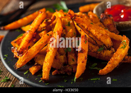 Homemade Organic Pumpkin French Fries with Ketchup - Stock Photo