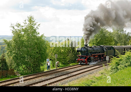 Steam train behind class 41 locomotive no. climbing the 'Schiefe Ebene' incline near Neuenmarkt, Franconia, Bavaria - Stock Photo
