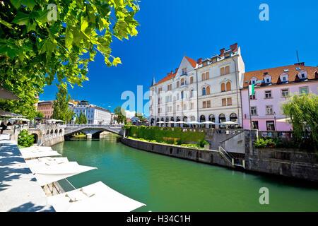 Ljubljana city center on green Ljubljanica river, capital of Slovenia - Stock Photo