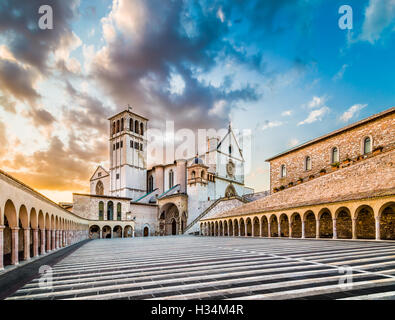 Famous Basilica of St. Francis of Assisi (Basilica Papale di San Francesco) with Lower Plaza at sunset in Assisi, - Stock Photo