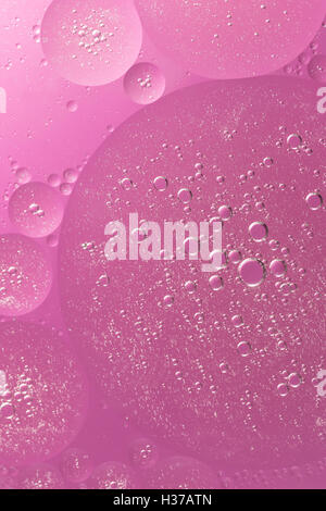 Abstract of oil droplet of various sizes. All is in a pink color hues. - Stock Photo